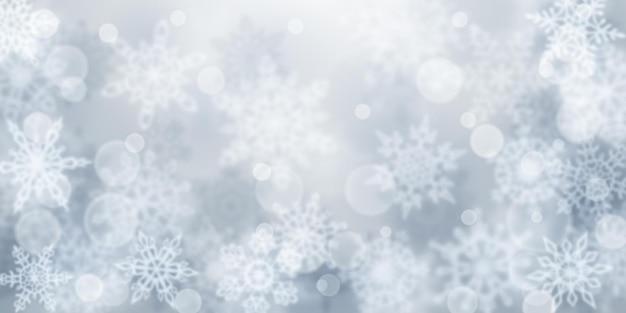 Fundo de natal com flocos de neve borrados em cores cinza