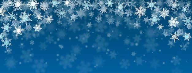Fundo de natal com flocos de neve caindo em cores azuis