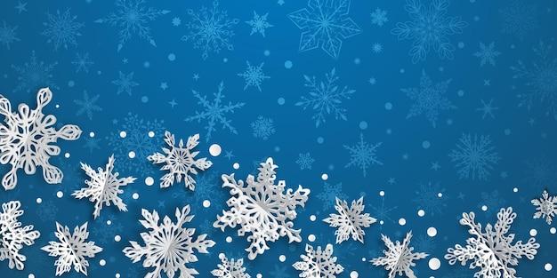 Fundo de natal com flocos de neve de papel volumoso com sombras suaves em fundo azul claro