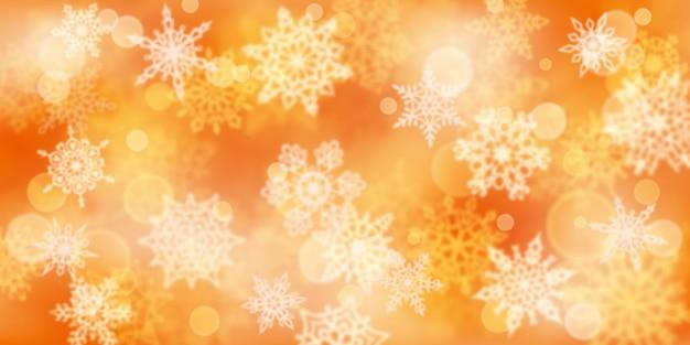 Fundo de natal com flocos de neve desfocados em cores amarelas
