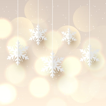 Fundo de natal com flocos de neve pendurados e design de luzes bokeh