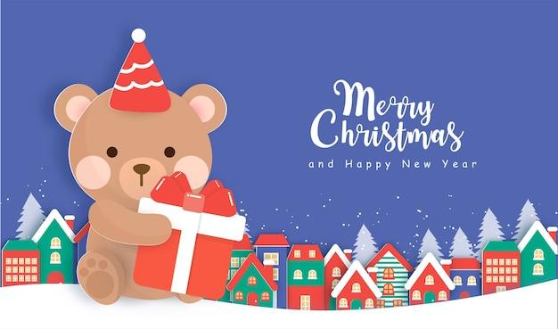 Fundo de natal com fofo urso de pelúcia em estilo de corte de papel.