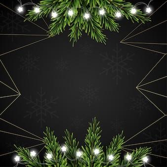Fundo de natal com galhos de pinheiro em fundo escuro