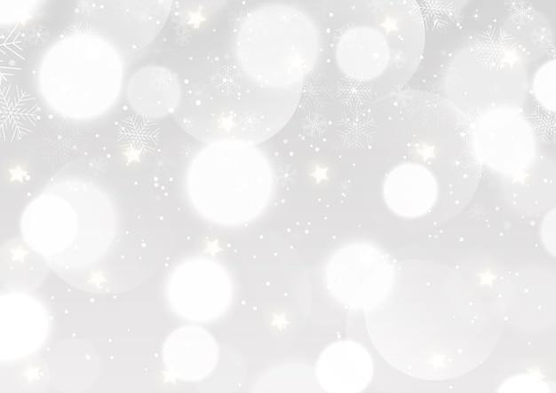 Fundo de natal com luzes de bokeh prateado e desenho de flocos de neve