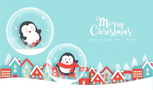 Fundo de natal com pinguins fofos na aldeia de neve e espaço ou texto.
