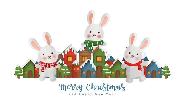 Fundo de natal com uma vila de neve e coelhos.