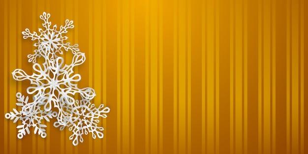 Fundo de natal com vários flocos de neve de papel com sombras suaves em fundo amarelo listrado