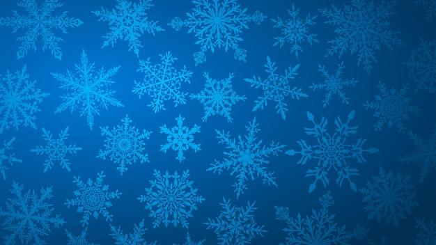 Fundo de natal com vários flocos de neve grandes e pequenos complexos em cores azuis