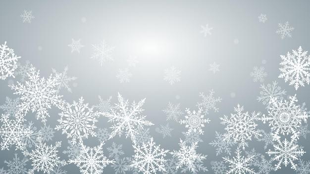 Fundo de natal com vários flocos de neve grandes e pequenos complexos em cores cinza