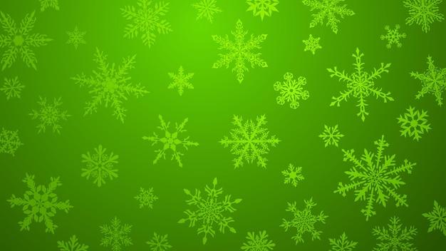 Fundo de natal com vários flocos de neve grandes e pequenos complexos em cores verdes