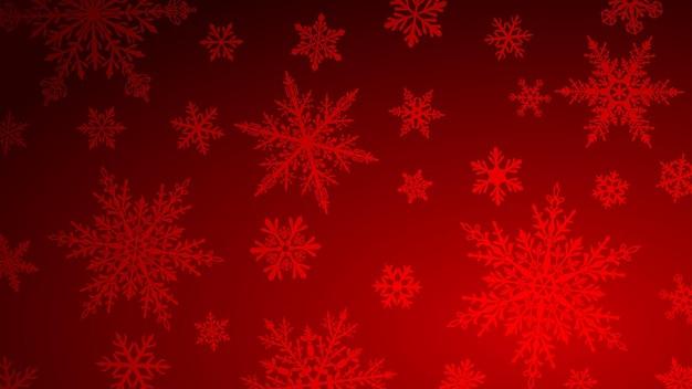 Fundo de natal com vários flocos de neve grandes e pequenos complexos em cores vermelhas