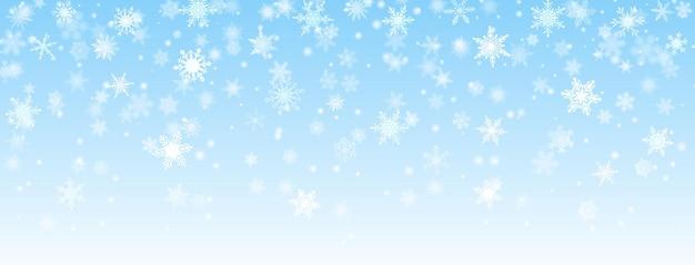 Fundo de natal de flocos de neve caindo em cores azuis claras