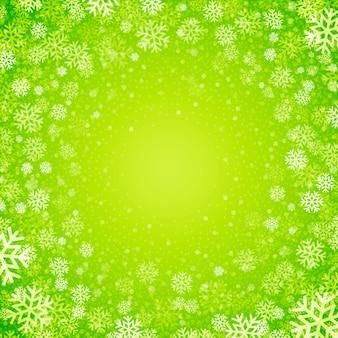 Fundo de natal de flocos de neve nas cores verdes