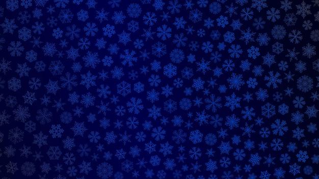 Fundo de natal de pequenos flocos de neve em cores azuis escuras