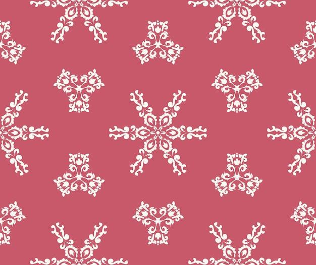 Fundo de natal flocos de neve brancos em um fundo rosa ornamento branco sem costura padrão em rosa