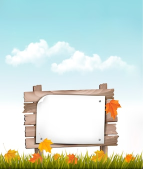 Fundo de natureza com folhas de outono e placa de madeira