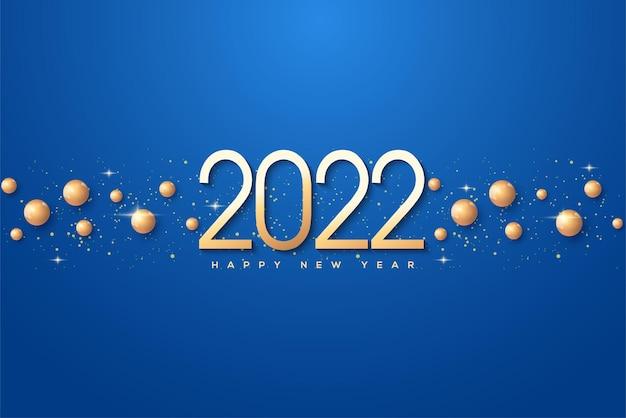 Fundo de números de ouro de 2022 e grãos de ouro em fundo azul