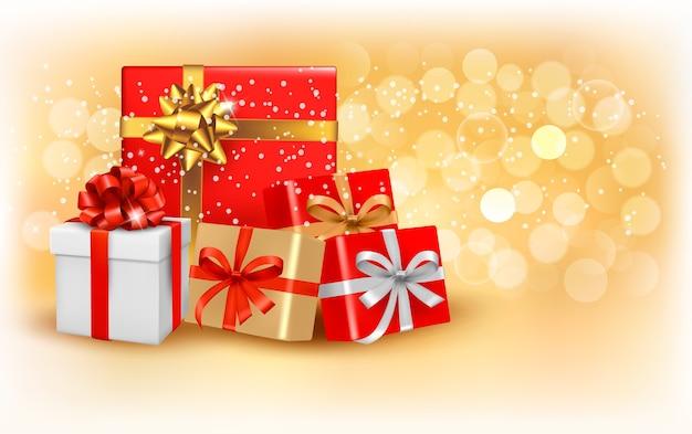 Fundo de ouro de natal com caixa de presente e floco de neve.