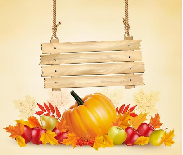 Fundo de outono com licença e placa de vegetal e de madeira. vetor. Vetor Premium