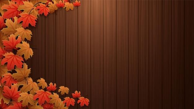 Fundo de outono com textura de madeira marrom, folhas de bordo vermelhas e amarelas