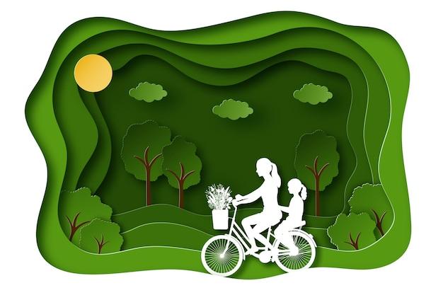 Fundo de paisagem de verão em estilo de corte de papel mãe e filha andam de bicicleta no fundo da natureza