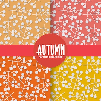 Fundo de papel floral outono com frutos silvestres em fundo colorido