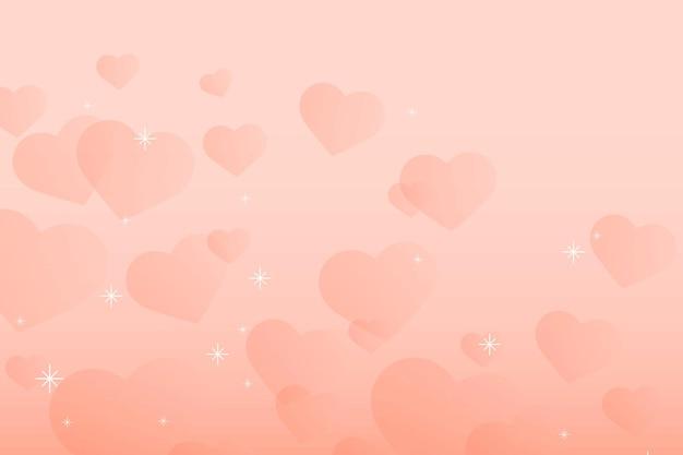 Fundo de pêssego com padrão de coração brilhante