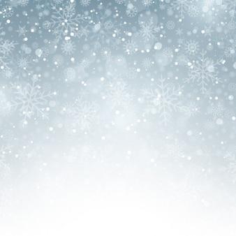 Fundo de prata do inverno com flocos de neve