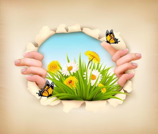 Fundo de primavera com as mãos, rasgando papel para mostrar uma paisagem. vetor.