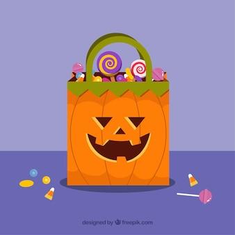 Fundo de saco de abóbora com doces