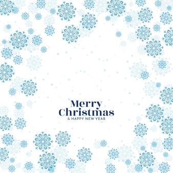 Fundo de saudação do festival de feliz natal com flocos de neve azuis
