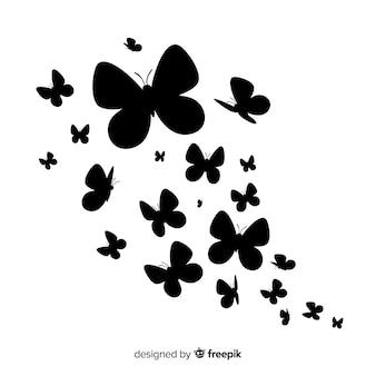 Fundo de silhueta de enxame de borboleta