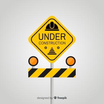 Fundo de sinal de aviso de construção plana