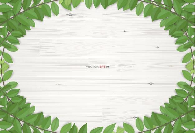 Fundo de textura de madeira com folhas verdes