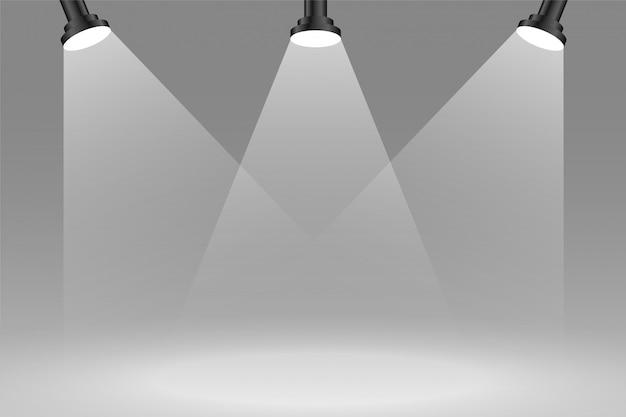 Fundo de três sportlights de foco na cor cinza