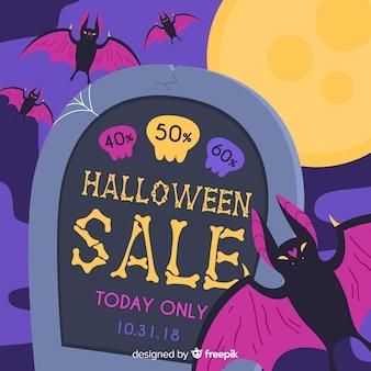 Fundo de venda de halloween com bastão e lápide