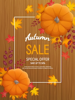 Fundo de venda de outono. folheto de banner vertical com abóbora, folhas em uma mesa de madeira.