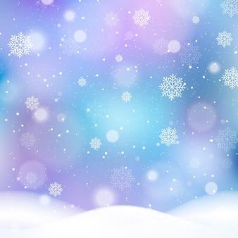 Fundo desfocado de inverno com flocos de neve