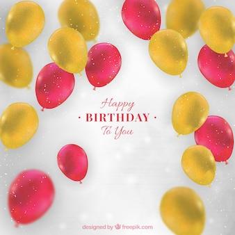 Fundo do aniversário com balões realistas em cores amarelas e vermelhas