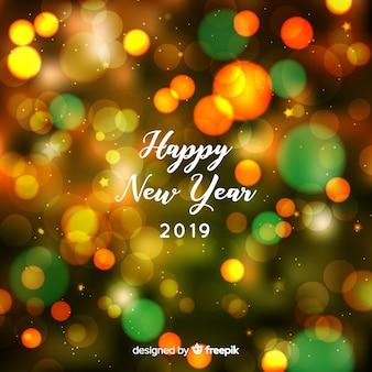 Fundo do ano novo 2019 turva Vetor grátis