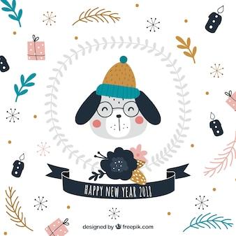 Fundo do ano novo com um cão bonito que desgasta o chapéu e os óculos