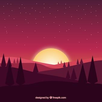 Fundo do campo no crepúsculo com pinheiros e montanhas