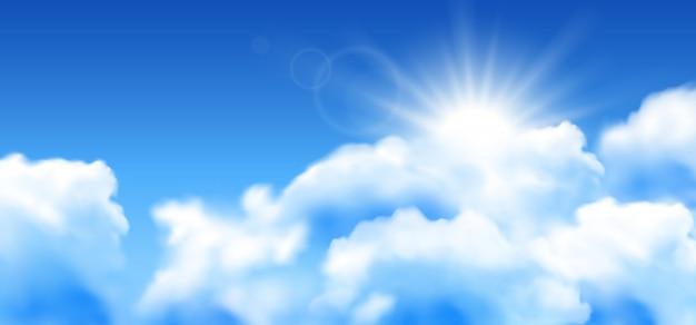 Fundo do céu azul com nuvens brancas e sol.