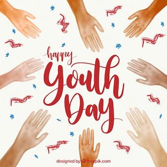 Fundo do dia da juventude com as mãos da aguarela