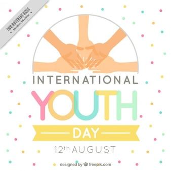 Fundo do dia internacional da juventude com as mãos e manchas coloridas