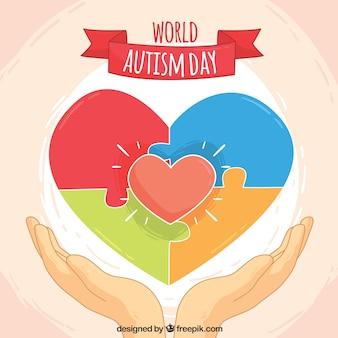 Fundo do dia mundial do autismo com coração e quebra-cabeça