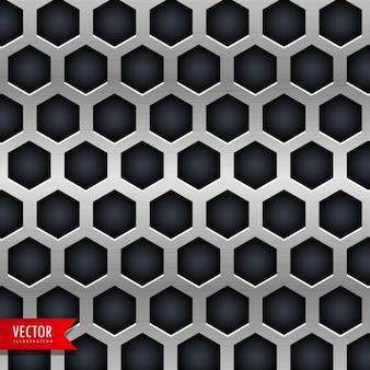 Fundo do metal com furos de formas hexagonais