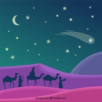 Fundo do natal com as silhuetas dos homens sábios