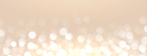 Fundo dourado atraente com efeito de luz bokeh