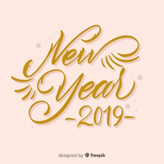 Fundo dourado caligráfico de ano novo